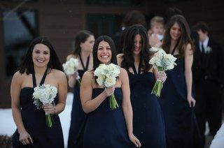 winter-wedding-bridesmaids-in-snow-with-white-bouquets