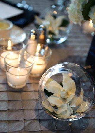 gardenia-in-glass-sphere-vase-at-wedding-reception