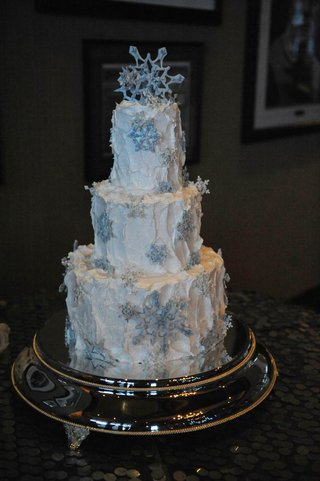 frozen-theme-winter-wedding-cake-with-blue-snowflakes-and-white-frosting