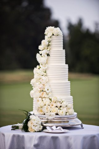 five-tier-wedding-cake-with-cascading-waterfall-of-ivory-flowers
