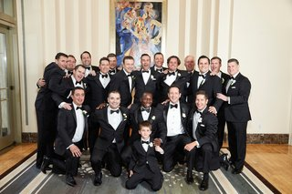 groom-and-groomsmen-in-tuxedos-with-ring-bearer-at-chicago-wedding
