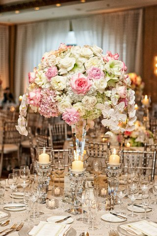 wedding-reception-table-with-roses-hydrangeas-orchids-in-white-pink-green-crystal-candlehold