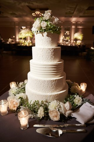 wedding-cake-with-design-of-brides-dress-and-fresh-flowers-at-top-and-base-gluten-free