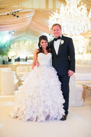 bride-in-kenneth-pool-wedding-dress-and-groom-in-tuxedo