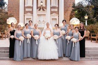 bridesmaids-wearing-serenity-grey-bridesmaid-dresses-with-bride-in-vera-wang-wedding-dress