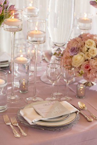 wedding-reception-lavender-purple-linen-silver-rim-glasses-floating-candles-low-centerpiece