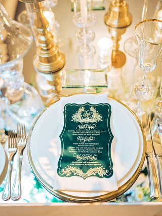 wedding-reception-mirror-table-gold-charger-emerald-green-and-gold-die-cut-menu-card-monogram-crest