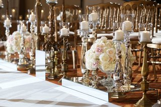 mirror-boxes-next-to-white-aisle-runner-candle-holder-candelabra-white-candlelight