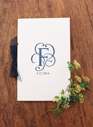 white-ceremony-booklet-with-surname-initial
