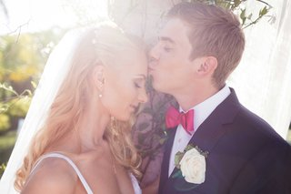 groom-kisses-the-bride-on-her-forehead-couple-portrait