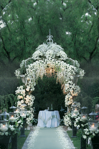 gazebo-decorated-with-white-flowers-and-chandelier-for-a-wedding