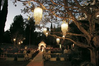 garden-ceremony-with-chandeliers-suspended-from-trees-and-flower-covered-gazebo