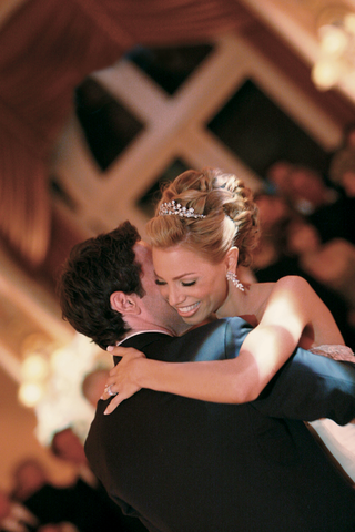 bride-in-a-tiara-and-groom-having-their-first-dance