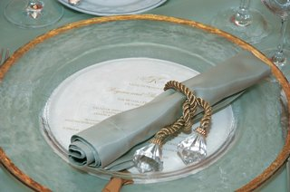place-setting-with-clear-gold-rimmed-charger-and-celadon-napkin-for-a-wedding-reception