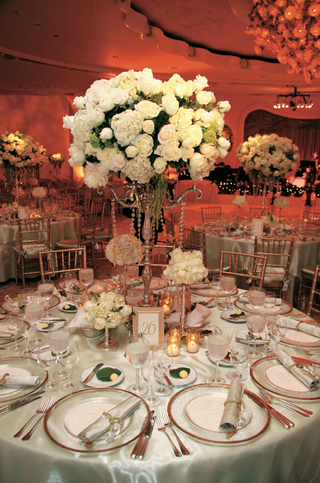 wedding-reception-centerpiece-of-white-roses-and-hydrangeas-in-a-silver-candelabra