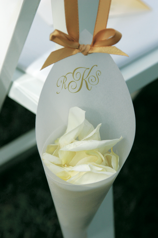 paper-cone-filled-with-rose-petals-and-hung-from-a-chair-for-a-wedding