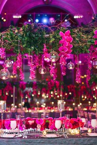overhead-wedding-flower-arrangement-with-cascading-orchid-glass-sphere-over-flower-runner