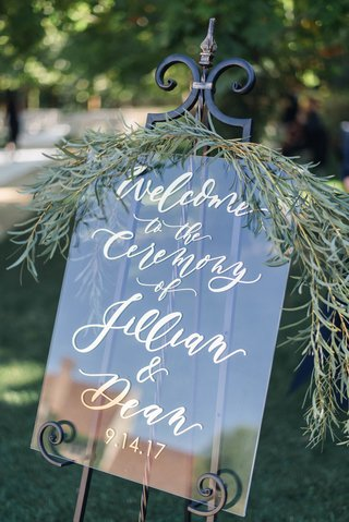 jillian-murray-and-dean-geyer-wedding-ceremony-welcome-sign-with-fresh-greenery-gold-calligraphy