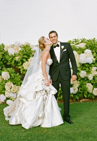 bride-in-pick-up-ball-gown-skirt-with-tuxedo-groom