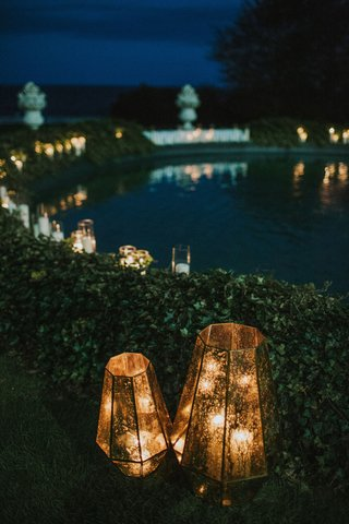 wedding-reception-decorated-with-lanterns-hedge-wall-pond-fountain-statues-newport-rhode-island