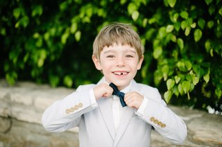 ring-bearer-in-light-suit-and-navy-bow-tie