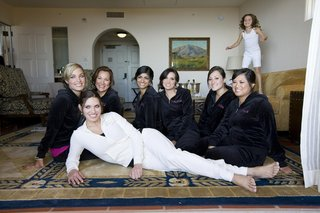bride-in-a-white-velour-outfit-with-bridesmaids-in-black-velour-outfits