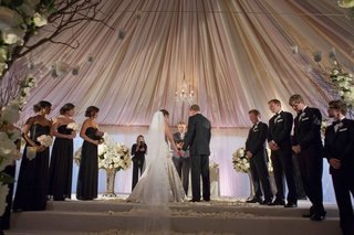 tented-wedding-ceremony-with-a-draped-blush-and-ivory-ceiling