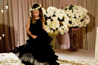 flower-girl-in-a-sleeveless-black-dress-with-a-white-floral-halo