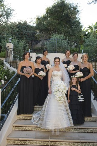 bride-in-a-strapless-vera-wang-gown-with-bridesmaids-in-long-strapless-black-dresses