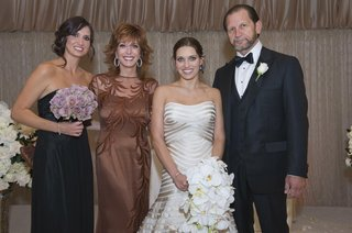 bride-in-a-strapless-vera-wang-gown-with-family