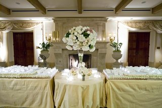 wedding-reception-place-cards-set-on-stands-decorated-with-white-roses