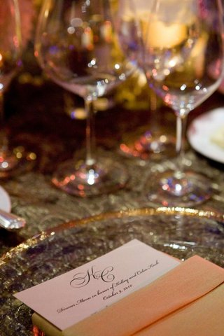 wedding-reception-place-setting-with-a-menu-tucked-into-a-napkin
