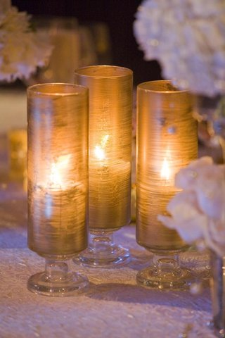 wedding-reception-table-with-golden-glass-candle-holders