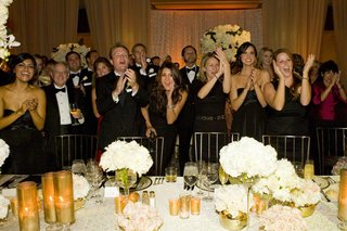 guests-to-a-black-tie-wedding-cheer-on-the-bride-and-groom