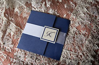 wedding-invitation-with-a-blue-exterior-ribbon-and-monogrammed-seal