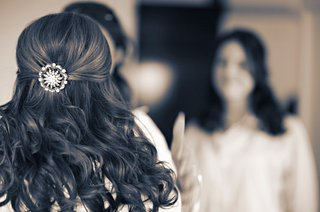 black-and-white-photo-of-brides-hairdo-with-a-round-rhinestone-barrette