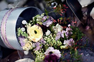 wedding-reception-floral-arrangement-of-yellow-white-light-purple-and-red-flowers