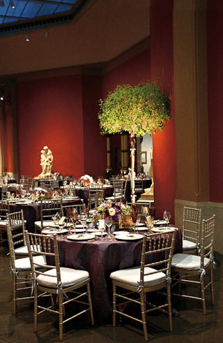 wedding-reception-with-dark-tablecloths-and-a-tree