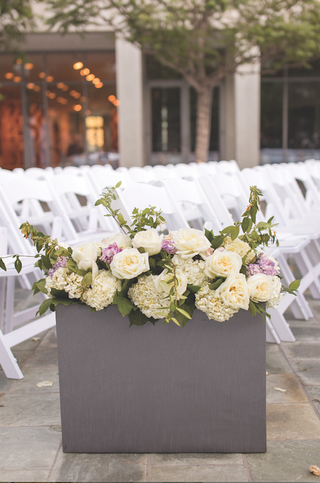 grey-box-filled-with-hydrangeas-and-roses