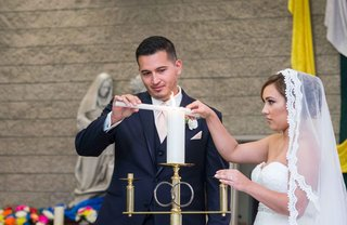 catholic-bride-groom-light-candle-long-veil-church-religious-wedding-california