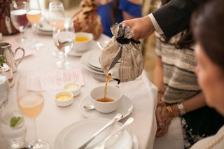 server-pouring-tea-into-tea-cup-at-bridal-shower