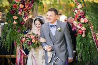 bride-in-a-claire-pettibone-dress-with-gold-and-silver-embroidery-veil-with-groom-in-grey-suit