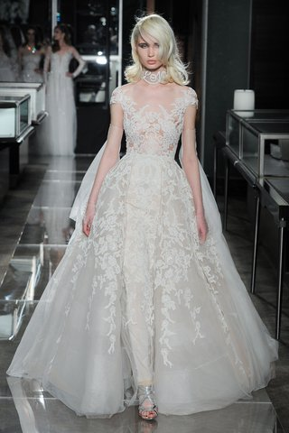 a-lace-embroidered-gown-with-an-attached-kankan-overskirt-by-reem-acra