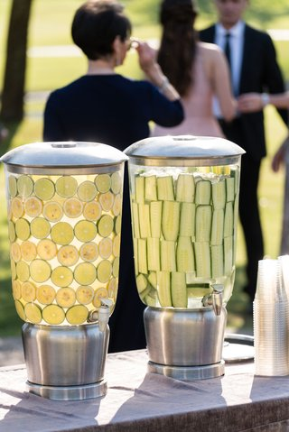 outdoor-ceremony-with-water-drink-dispensers-lemon-lime-flavor-and-cucumber
