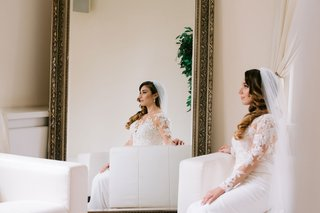 bride-in-lace-long-sleeve-pronovias-dress-bride-reflected-in-mirror