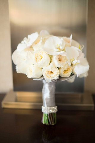 off-white-peonies-and-orchids-in-crystal-rimmed-ribbon