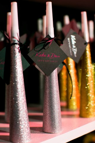 glittering-silver-and-gold-noisemakers-given-to-guests-as-favors-for-this-new-years-eve-wedding