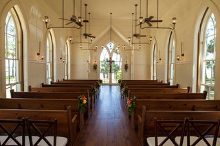 chapel-in-bluffton-south-carolina-church-wedding-venue-glass-windows-pews-industrial-lights-simple