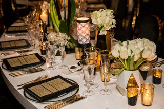 white-table-gold-flatware-black-and-gold-place-setting-white-vase-tulips-calla-lily-gold-candles