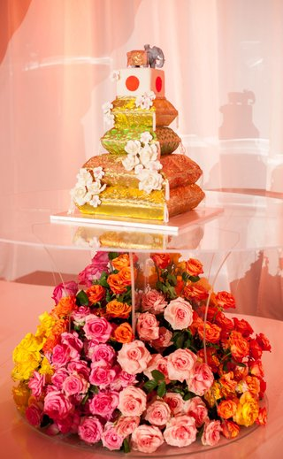 wedding-cake-with-cushions-japanese-flag-cube-elephant-on-top-roses-on-lucite-stand